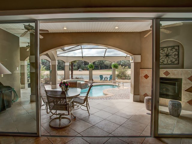 Enjoy afternoons lounging at the heated pool while gazing at the beauty of the nearby lake in this  Destin FL home for sale.