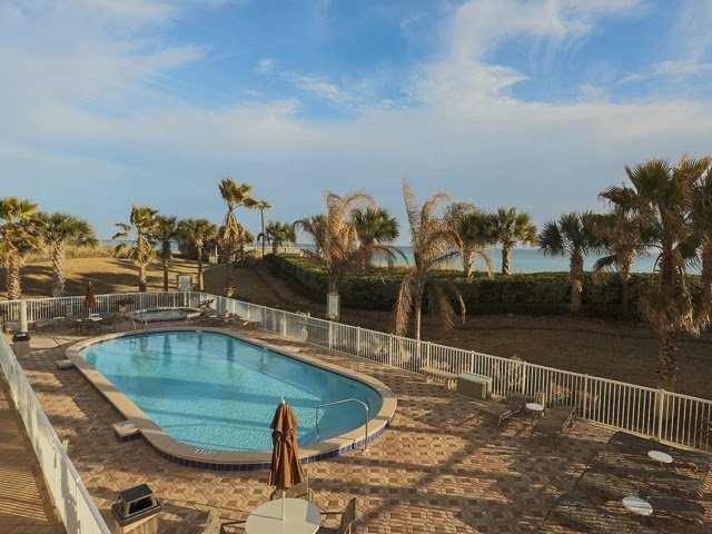 A high-rise condomium unit, a striking view of the ocean and landscape, immaculate interiors and top-notch amenities - this Destin FL condo for sale has it all!