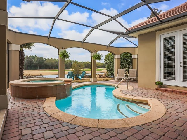 Enjoy your days lounging at the heated pool while gazing at the beauty of the nearby lake in this  Destin FL home for sale.