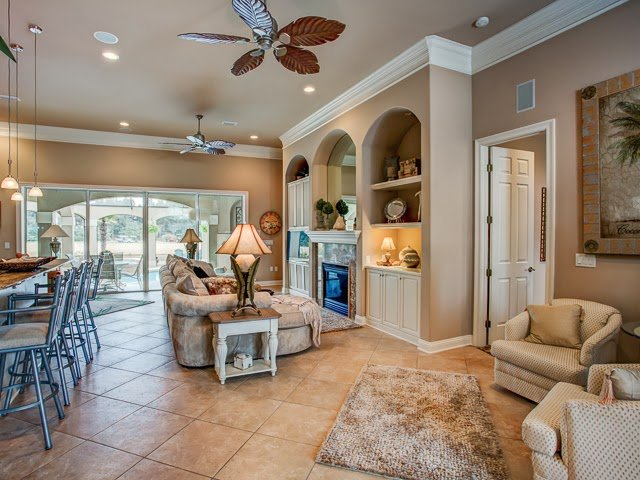 Enjoy afternoons lounging at the pool while gazing at the beauty of the nearby lake in this  Destin FL home for sale.