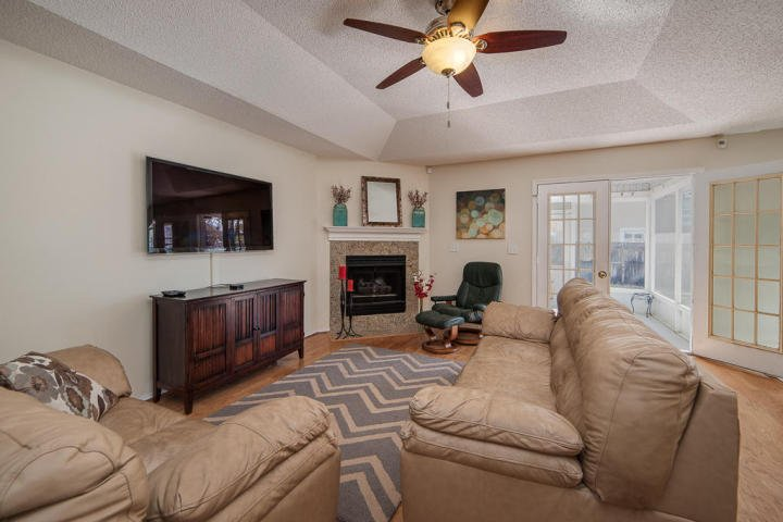The cozy and spacious living room of this Bluewater Bay home for sale is not only inviting but also relaxing.
