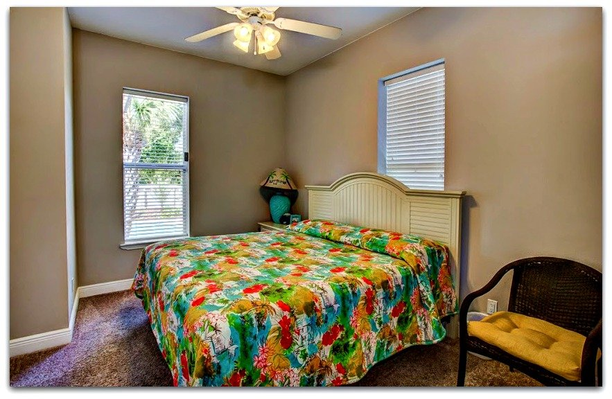 One of the 3 spacious bedrooms is located on the first floor of this Crystal Beach FL home.
