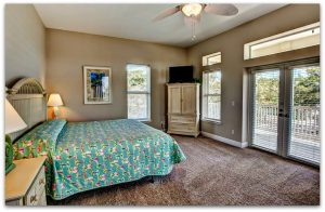 One of the best features of this home is the master suite that has french doors that lead to the covered deck.