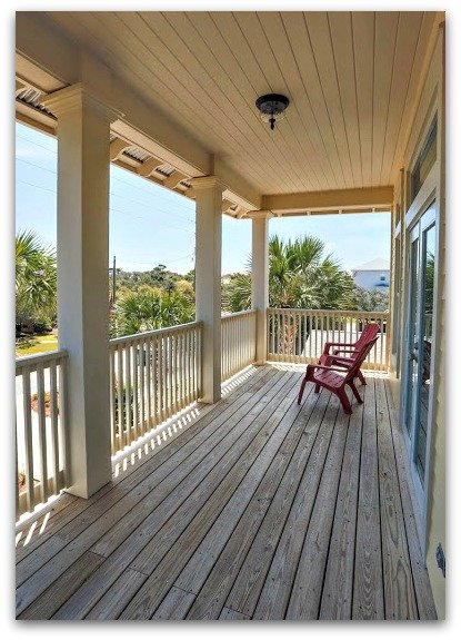 Enjoy the breathtaking view and sound of nature as you spend lazy afternoons in the covered deck of this home for sale in Destin FL.
