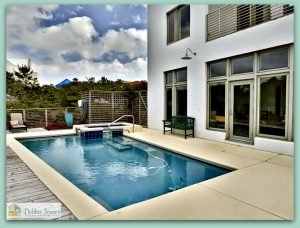 The exterior of this gorgeous lakefront home in Santa Rosa Beach boasts of a lovely pool and spa.