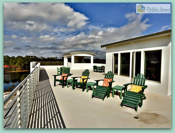Enjoy 360 degrees of breathtaking views in this incredible Santa Rosa Beach FL home.