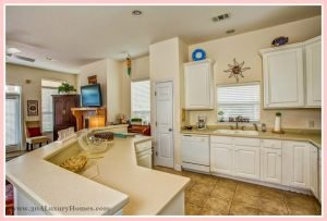 Even the kitchen in this home for sale in Seacrest FL exudes warmth and comfort - inspiring sumptuous meals shared with loved ones.