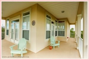 The wrap-around porch in this stunning beach home for sale in Seacrest FL is simply hard to resist with the surrounding spectacular views for you to indulge in.