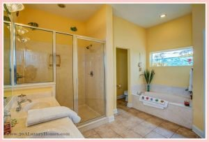 An expansive master suite with an immaculate ensuite bath awaits you in this home for sale in Seacrest FL.