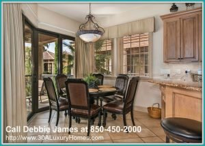 A chat or a meal will be best shared with loved ones in the inviting dining area of this delightful Miramar Beach FL home for sale.