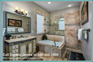 End your days with a soothing shower in the spa-like bathroom of this dazzling Miramar Beach FL home for sale.