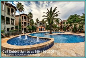 A tropical lagoon style pool with a heated jacuzzi is one of the impressive amenities in this Mediterranean Tuscan style community where this pristine home for sale in Miramar Beach FL is seated.