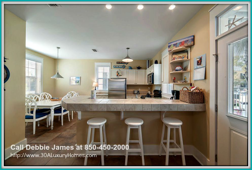 This breakfast bar is the perfect place for a quick snack or meal during the day when you own this charming Seagrove Beach FL home for sale.