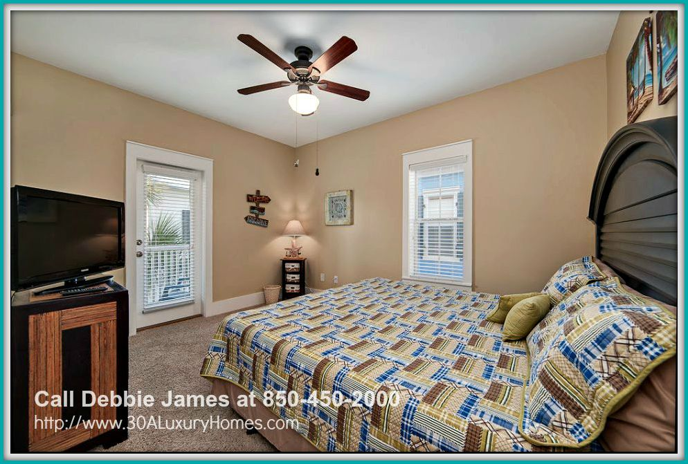 You will love the retreat the master suite in this 2 bedroom beach cottage for sale in Seagrove Beach FL provides after enjoying fun outdoor activities nearby.